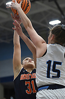 Heritage Aleyshka Pabón (31) shoots the ball as Har-Ber forward Sophie Nelson (15) covers, Friday, February 7, 2020 during a basketball game at Wildcat Arena at Har-Ber High School in Springdale. Check out nwaonline.com/prepbball/ for today's photo gallery.<br /> (NWA Democrat-Gazette/Charlie Kaijo)