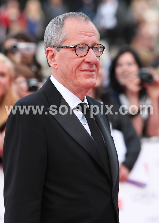**ALL ROUND PICTURES FROM SOLARPIX.COM**                                             **WORLDWIDE SYNDICATION RIGHTS**                                                                                  Caption: outside arrivals at the L'Oreal Paris National Movie Awards 2011, Held at London's Wembley Arena, London, UK. 11 May 2011                                                                           This pic: Geoffrey Rush                                                                                              JOB REF: 13321 WMB       DATE: 11_05_2011                                                           **MUST CREDIT SOLARPIX.COM OR DOUBLE FEE WILL BE CHARGED**                                                                      **MUST AGREE FEE BEFORE ONLINE USAGE**                               **CALL US ON: +34 952 811 768 or LOW RATE FROM UK 0844 617 7637**