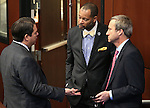From left, Nevada Sens. Michael Roberson, Aaron Ford and Greg Brower talk on the Senate floor at the Legislative Building in Carson City, Nev., on Friday, April 3, 2015. <br /> Photo by Cathleen Allison