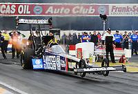 Feb. 12, 2012; Pomona, CA, USA; NHRA top fuel dragster driver Antron Brown during the Winternationals at Auto Club Raceway at Pomona. Mandatory Credit: Mark J. Rebilas-