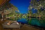 Poolside deck chair at dusk