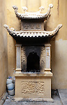 Hanoi, Vietnam, a furnace for burning incense and other luck bearing papers. photo taken July 2008.