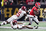 Georgia Bulldogs wide receiver Riley Ridley (8) gets past Alabama Crimson Tide defensive back Ronnie Harrison (15) and Alabama Crimson Tide defensive back Levi Wallace (39) in the first half of the NCAA College Football Playoff National Championship at Mercedes-Benz Stadium on January 8, 2018 in Atlanta. Photo by Mark Wallheiser/UPI