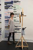 London, England. 14 October 2014. Performance artists at the stand of Barbara Seiler gallery.  Frieze Art Fair 2014 opens in Regent's Park, London. Photo: Bettina Strenske