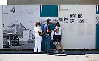 24 AUG 2009 - BERLIN, GER - Visitors read the history of the Berlin Wall at the outdoor exhibition on Friedrichstrafze (PHOTO (C) NIGEL FARROW)