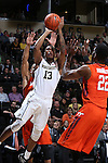 28 February 2016: Wake Forest's Bryant Crawford (13) shoots over Virginia Tech's Johnny Hamilton (TRI) (22). The Wake Forest University Demon Deacons hosted the Virginia Tech Hokies at Lawrence Joel Veterans Memorial Coliseum in Winston-Salem, North Carolina in a 2015-16 NCAA Division I Men's Basketball game. Virginia Tech won the game 81-74.