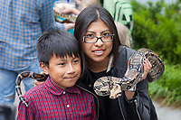 Mother and son holding snake, Northwest Folklife Festival 2015, Seattle Center, WA, USA.