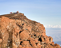 Climbers at the summit of Kilimanjaro on Uhuru Peak, seen from Stella Ridge.