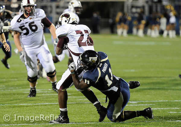 Florida International University football player defensive back Ashlyn Parker (11) plays against the University of Louisiana Monroe on November 06, 2010 at Miami, Florida. FIU won the game 42-35 in double overtime. .