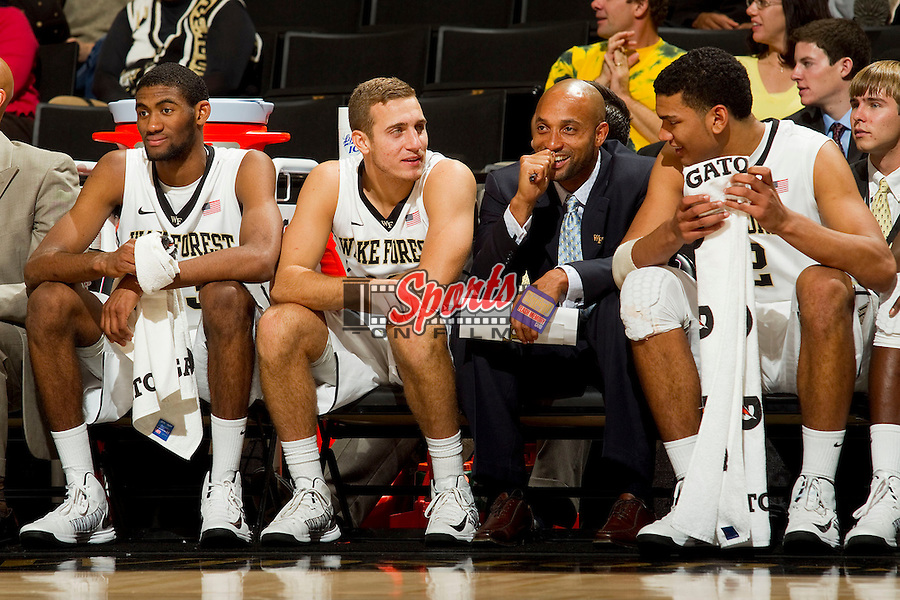 (L-R) Aaron Roundtree III (33), Chase Fischer (10), Randolph Childress and Devin Thomas (2) share a laugh during second half action against the Rollins Tars at the LJVM Coliseum on November 2, 2012 in Winston-Salem, North Carolina.  The Demon Deacons defeated the Tars 73-66.    (Brian Westerholt/Sports On Film)