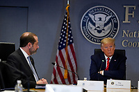 United States President Donald J. Trump listens during a teleconference with governors at the Federal Emergency Management Agency headquarters, Thursday, March 19, 2020, in Washington, DC. US Secretary of Health and Human Services (HHS) Alex Azar is at left.<br /> Credit: Evan Vucci / Pool via CNP/AdMedia