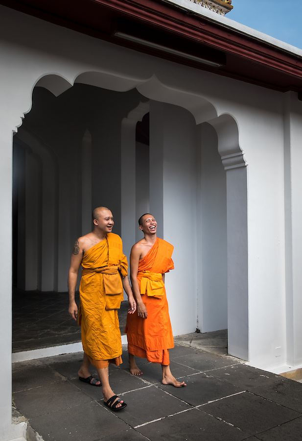 BANGKOK, THAILAND - CIRCA SEPTEMBER 2014: Buddhist monks walking relaxed inside Wat Arun, a  popular Buddhist temple in Bangkok Yai district of Bangkok, Thailand, on the Thonburi west bank of the Chao Phraya River