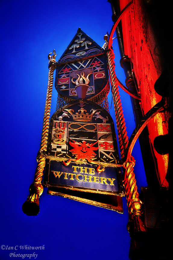 Looking up at the Witchery Restaurant sign in Edinburgh.