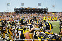 July 10, 2010; Hamilton, ON, CAN; Hamilton Tiger-Cats players gather at centrefield prior to the game. CFL football: Calgary Stampeders vs. Hamilton Tiger-Cats at Ivor Wynne Stadium. The Tiger-Cats lost against the Stampeders 23-22. Mandatory Credit: Ron Scheffler. Copyright (c) 2010 Ron Scheffler.