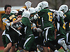 Brandon Aviles #9 of Ward Melville (without helmet), left, and teammates celebrate after their 9-8 win over host Chaminade High School in a varsity boys lacrosse game on Saturday, Apr. 2, 2016.