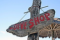 sign for dive shop carved into driftwood