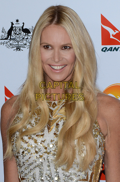 Elle Macpherson.at The G'Day USA Black Tie Gala held at The JW Marriot at LA Live in Los Angeles, California, January 12th 2013..portrait headshot dyed blonde hair roots smiling white gold silver beaded .CAP/ADM/TW.©Tonya Wise/AdMedia/Capital Pictures.