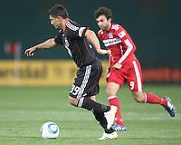 Jaime Moreno #99 of D.C. United gets away from Baggio Husdic #9 of the Chicago Fire during an MLS match on April 17 2010, at RFK Stadium in Washington D.C. Fire won the match 2-0.