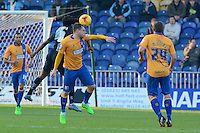 Wycombe Wanderers Marcus Bean and Mansfield Town's Adam Chapman battle in the air during the Sky Bet League 2 match between Mansfield Town and Wycombe Wanderers at the One Call Stadium, Mansfield, England on 31 October 2015. Photo by Garry Griffiths.