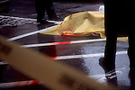 Seattle, man's body beneath yellow crime scene sheet, suicide by jumping,