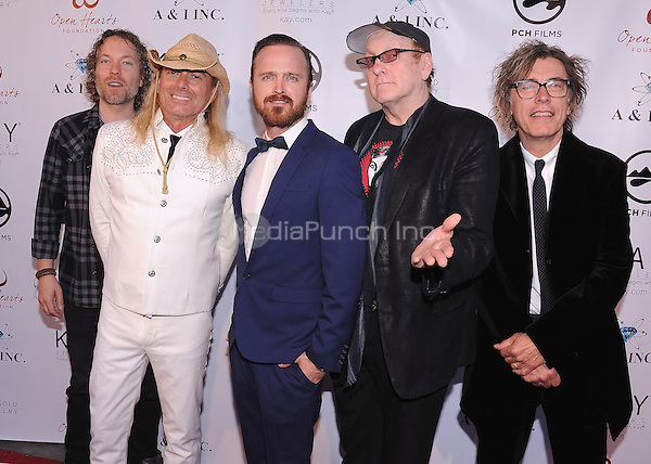 MALIBU, CA - MAY 10:  Aaron Paul and Cheap Trick at the 4th Annual Open Hearts Gala at a private residence on May 10, 2014 in Malibu, California. Credit: PGSK/MediaPunch