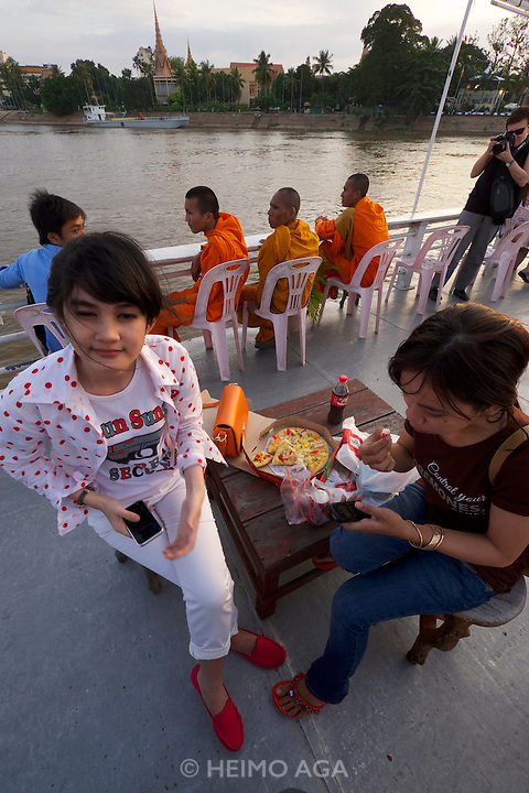 Phnom Penh, Cambodia. Sunset cruise to the confluence of Tonle Sap and Mekong river.