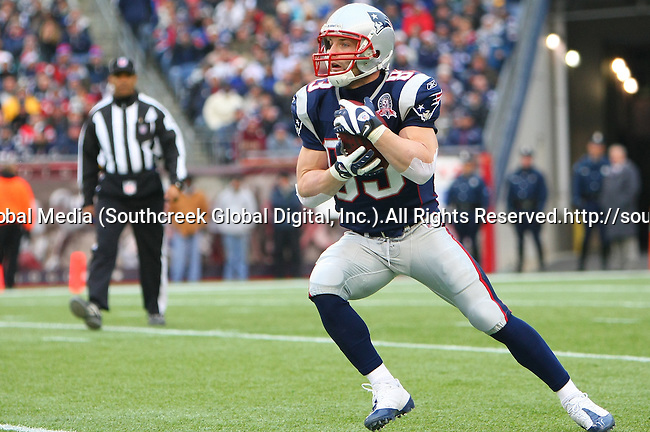13December2009: New England Patriot wide receiver Wes Welker #83 gains yardage after a pass reception in the first quarter. The New England Patriots defeated the Carolina Panthers 20-10 at Gillette Stadium in Foxborough, Massachusetts.
