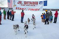 Joan Klejka crosses the finish line of the 2016 Junior Iditarod in Willow, Alaska, AK  February 28, 2016