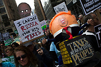 NEW YORK, NY - APRIL 15: People take part in a Tax Day protest on April 15, 2017 in New York City. Thousands of activists march to Trump Tower to demand that President Donald Trump release his tax returns. Photo by VIEWpress/Eduardo MunozAlvarez
