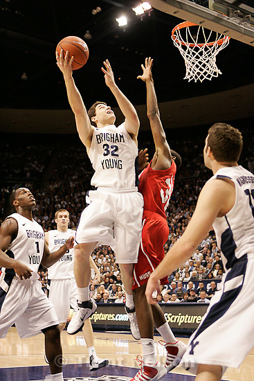 Trent Nelson  |  The Salt Lake Tribune.BYU's Jimmer Fredette shoots with Utah's Shawn Glover defending in the first half at BYU vs. Utah, college basketball in Provo, Utah, Saturday, February 12, 2011.