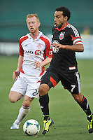 Dwayne De Rosario (7) of D.C. United goes against Richard Eckersley (27) of Toronto FC. Toronto FC tied D.C. United 1-1, at RFK Stadium, Saturday August 24 , 2013.