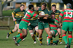 D. Crighton is stopped by P. Tavia & T. Parry. Counties Manukau Premier Club Rugby, Pukekohe v Waiuku  played at the Colin Lawrie field, on the 3rd of 2006.Pukekohe won 36 - 14
