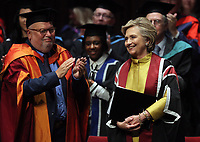 Pictured: Hillary Clinton (R) on stage while being award her honorary degree at Swansea University Bay Campus. Saturday 14 October 2017<br />