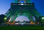 The basis of the Eiffel tower in Paris, France, by night