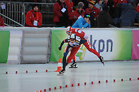 SCHAATSEN: BOEDAPEST: Essent ISU European Championships, 07-01-2012, 1500m Ladies, Martina Sábliková CZE in rit tegen Natalia Czerwonka POL, ©foto Martin de Jong