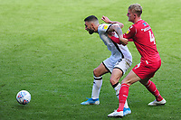 Borja Baston of Swansea City battles with Joe Worrall of Nottingham Forest during the Sky Bet Championship match between Swansea City and Nottingham Forest at the Liberty Stadium in Swansea, Wales, UK. Saturday 14 September 2019