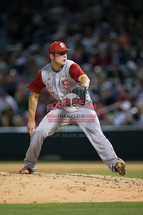 North Carolina State Wolfpack relief pitcher Jon Olczak (17) in action against the Charlotte 49ers at BB&T Ballpark on March 31, 2015 in Charlotte, North Carolina.  The Wolfpack defeated the 49ers 10-6.  (Brian Westerholt/Four Seam Images)