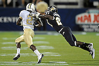 17 September 2011:  FIU defensive back Jose Cheeseborough (27) tackles UCF quarterback Jeff Godfrey (2) in the fourth quarter as the FIU Golden Panthers defeated the University of Central Florida Golden Knights, 17-10, at FIU Stadium in Miami, Florida.