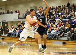 SIOUX FALLS, SD, FEBRUARY 10:  Mack Johnson #3 from the University of Sioux Falls drives against John Warren #3 from Augustana Friday night at the Stewart Center in Sioux Falls. (Photo by Dave Eggen/Inertia)