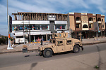 KIRKUK, IRAQ: An American humvee drives through the streets of Kirkuk...Residents of the city of Kirkuk vote for the first time.  Because of violence in the ethnically mixed city, Kirkuk was excluded from the 2005 elections...Photo by Kamaran Najm/Metrography