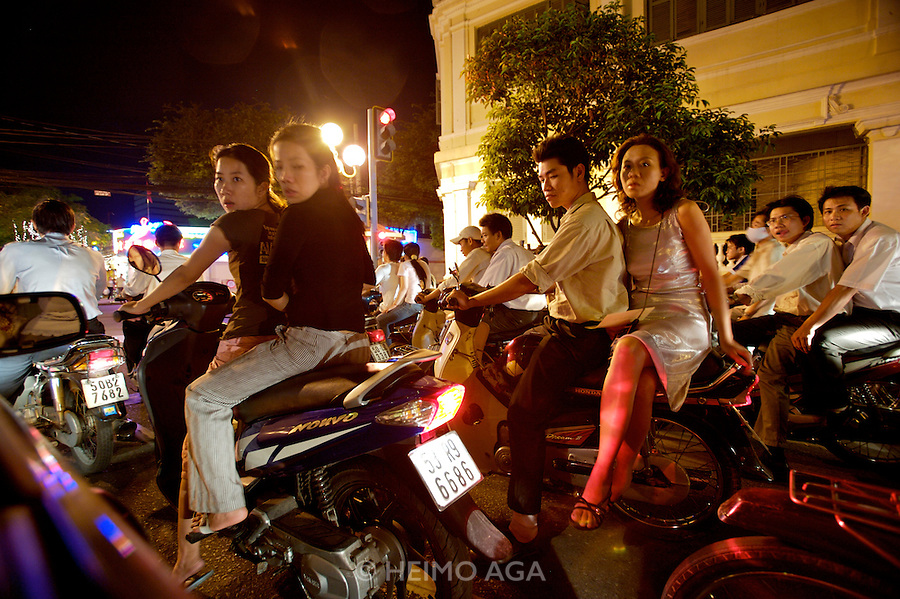 Young people with motorbikes enjoying the night.