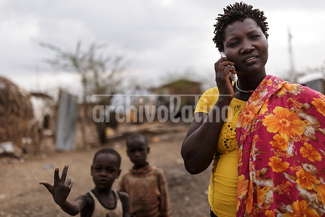 A family  in Kakuma refugee camp in Kenya.Kakuma refugee camp in North of Kenya. Kakuma is the site of a UNHCR refugee camp, established in 1991. The population of Kakuma town was 60,000 in 2014, having grown from around 8,000 in 1990. In 1991, the camp was established to host the 12,000 unaccompanied minors who had fled the war in Sudan and came walking from camps in Ethiopia.