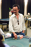David Pham can't believe the turn and river: Dragon Sets up Play, Gets No love.David Pham has been playing very aggressively at the final table, and it set him up perfectly against Shi Jia Liu. A hand after Pham made a nice squeeze play against Dan Harrington and Tom Schneider, he played a huge pot against Liu. Lui raised to 70,000 and Pham reraised 250,000 more. Lui thought, then moved all in. Pham insta-called, and had Lui's KQ dominated by his AK. Pham couldn't get his hand to hold however, as the board ran 1022QQ. Liu doubled his 443,000 and now is just short of 1 million.