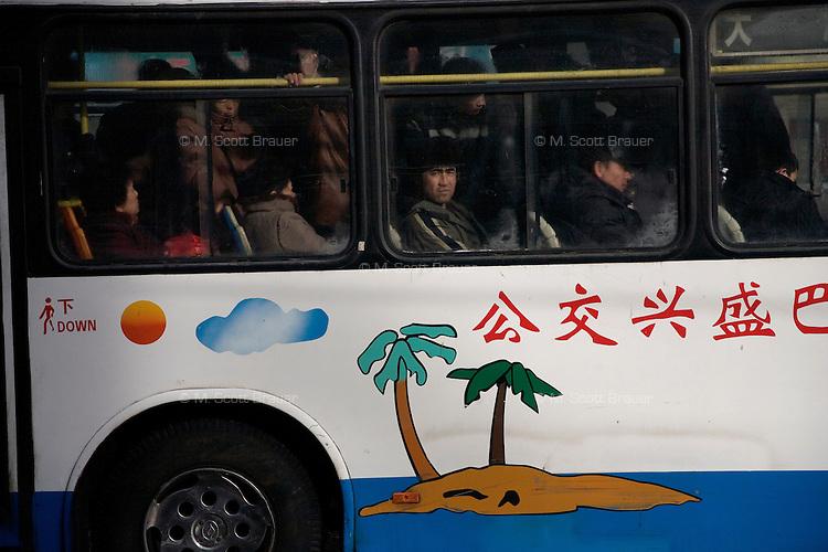 People ride a bus in Urumqi, Xinjiang, China.