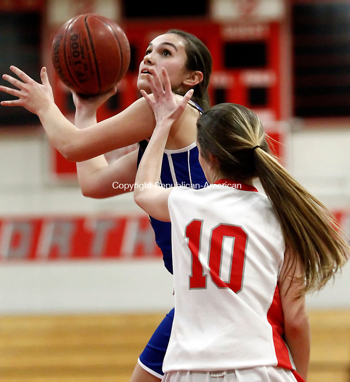 Winsted, CT- 05 January 2015-010515CM10 Lewis Mills' Natalie Ruel looks for the basket as Northwestern's Erika Swartley  defends during their Berkshire League matchup in Winsted on Monday.   Christopher Massa Republican-American