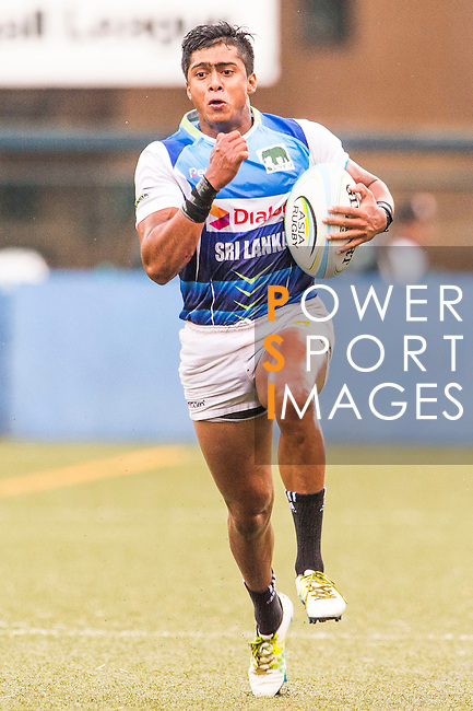 Thuwan Reeza Raffaideen of Sri Lanka runs with the ball during the match between Sri Lanka and Malaysia of the Asia Rugby U20 Sevens Series 2016 on 12 August 2016 at the King's Park, in Hong Kong, China. Photo by Marcio Machado / Power Sport Images