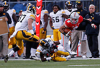 Ohio State Buckeyes wide receiver Devin Smith (9) gets tripped up by Iowa Hawkeyes defensive back Desmond King (14) in the third quarter of the NCAA football game between the Ohio State Buckeyes and the Iowa Hawkeyes at Ohio Stadium in Columbus, Saturday afternoon, October 19, 2013. The Ohio State Buckeyes defeated the Iowa Hawkeyes 34 - 24.  (The Columbus Dispatch / Eamon Queeney)