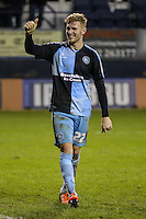 Jason McCarthy of Wycombe Wanderers gives the travelling fans the thumbs up after victory against Luton Town during the Sky Bet League 2 match between Luton Town and Wycombe Wanderers at Kenilworth Road, Luton, England on 26 December 2015. Photo by David Horn.