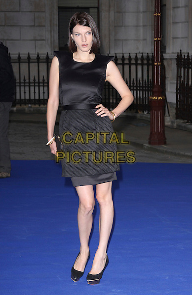 BEN GRIMES VIORT .Royal Academy of Arts Summer Exhibition Preview Party at the Royal Academy, Piccadilly, London, England. June 3rd, 2009..full length black dress shoes hand on hip.CAP/AH.©Adam Houghton/Capital Pictures