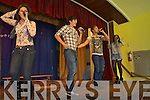 SCHOOL SPECIAL: Pop group Industry, whose hit single Burn is currently Number 1 in the Irish charts giving students in Scoil Eoin, Tralee a special performance on Tuesday.